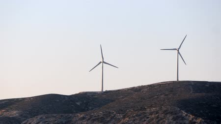 clean electricity production : Two Wind turbine power generators in the hills. Alternative renewable energy production in Rhodes, Greece