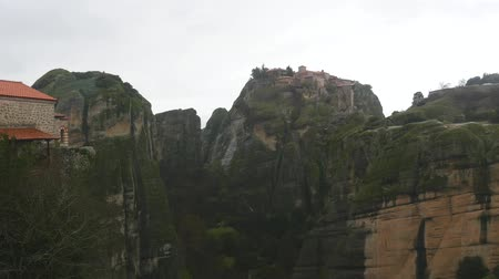 biggest : Monastery of Grand Meteoron the oldest and largest in Meteora mountains Greece in winter rainy weather