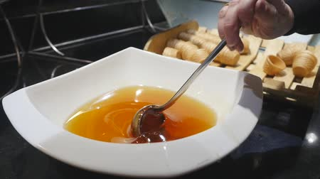 gofret : Food buffet in a luxury hotel. Closeup of womans hand taking some waffle and honey Stok Video