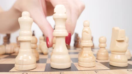 spare : Womans hand setting up white chess figures on the board Stock Footage