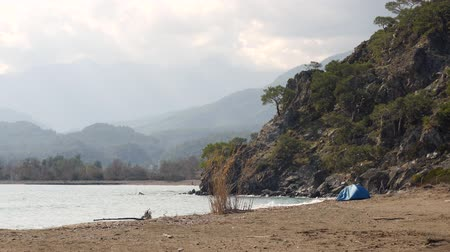 phaselis : Beautiful calm view seashore and mountains in Phaselis Kemer Turkey, touristic tent by the sea Stock Footage