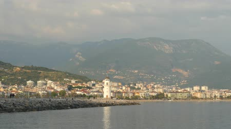 mediaeval : View of Alanya harbor with moving cars and people from Alanya Red brig tower. Turkish Riviera Stock Footage