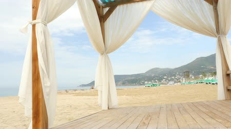 antalya : White gazebo and calm sea on background. Awaiting for summer season tourist in Alanya Cleopatra beach. Stock Footage