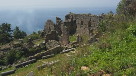 byzantský : Beautiful view of ancient castle ruins with calm Mediterranean sea on background. Just open, without tourists.