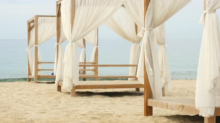 nesnel : White gazebo and calm sea on background. Awaiting for summer season tourist in Alanya Cleopatra beach. Stok Video