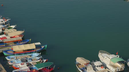 sycylia : Aerial view for fishing port with old wooden fishing boats in Turkey. Unrecognized fishermen sitting on the boat