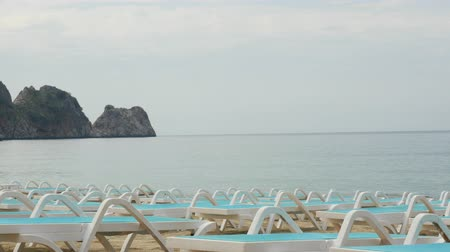 antalya : Empty deckchairs. Awaiting for summer season tourist in Alanya Cleopatra beach. Stock Footage