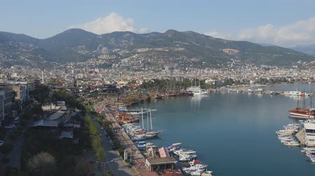 area of port : Panorama view of Alanya harbor with moving cars and people from Alanya Red brig tower. Turkish Riviera