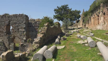 mediaeval : Panorama view of beautiful ancient castle greek column ruins with calm Mediterranean sea on background. Just open, without tourists.