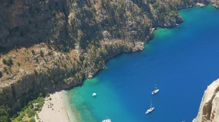 Эгейский : Beautiful aerial view of The Butterfly Valley (kelebekler vadisi) in the city of OludenizFethiye in western Turkey. You can only reach this valley by boat or rock climbing Стоковые видеозаписи