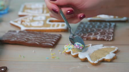 глазурь : A Young Girls Decorates Ginger Cookies Christmas Winter Evening. Woman Draws Icing On Honey