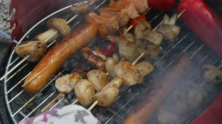timo : Close up assorted delicious grilled meat with vegetables over the coals on a barbecue.