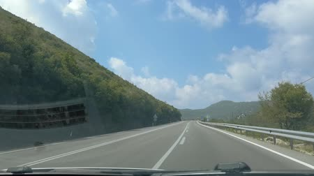 antalya : POV Vehicle driving shot. Car rides along the road along and mountains, empty road, summer trip.