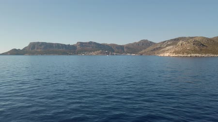 Front point of view from the ship moving to the Greek island Meis in summer clear day Stok Video