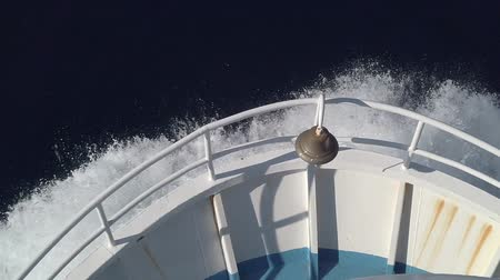 Ships bow, moving through the waves to the destination in slow motion. View from forecastle deck. Stok Video