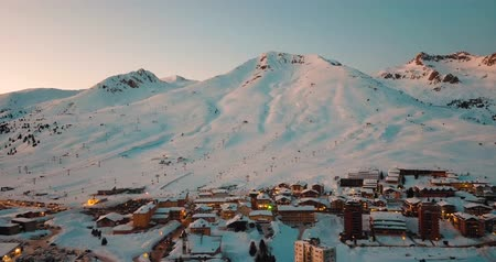 freeride : Sunset on the wonderful city on Passo del Tonale Shot this winter during an amazing sunny day Stock Footage