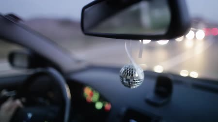 urychlit : Disco ball hanging in the car