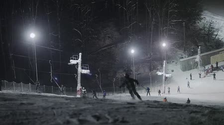 snowboard : People skiing at night