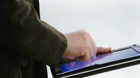usuário : Medium Shot of man working on tablet PC with touch screen Stock Footage