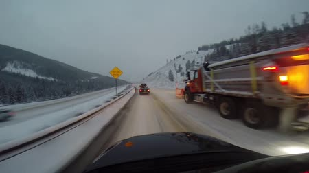 asfalt : Snowplows and Snowy Winter Driving on I-70 in Colorado
