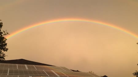 utilidade : Solar Panel Sunset Rainbow with Clouds and Time Lapse