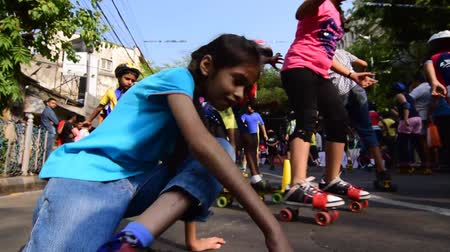 fall down : KOLKATA, WEST BENGAL  INDIA - MARCH 29TH : Unidentified city children rollerskating on blocked, otherwise busy,Park Street for Happy Street event, on 29.03.15. Children played, enjoyed and had fun.