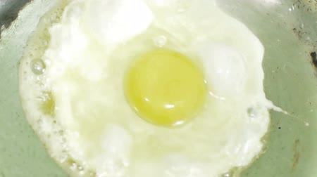 poached egg : Preparation of poached egg, close up stock footage, HD quality, 1920 x 1080. Stock Footage