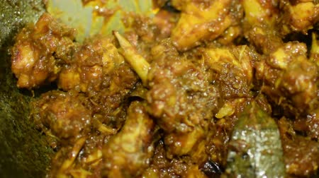 tikka : Preparation of smoking hot chicken curry, one of the spicy delicacies of Indian foods. India is famous for such colorful foods for long time.