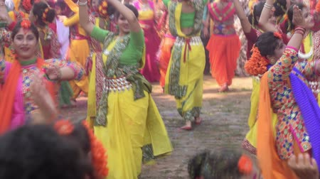 bengali : KOLKATA , INDIA - MARCH 12, 2017: Young girl dancers joyful dance at HoliSpring festival,known as Dol (in Bengali) or Holi (in Hindi) celebrating arrival of Spring in India. Popular Indian festival.