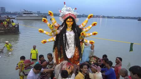 vijaya : KOLKATA, WEST BENGAL, INDIA - 30 SEPTEMBER 2017: Idol of Goddess Durga is being immersed in Holy river Ganges. Celebrated by Hindus as vijaya dashami, last day of Durga Puja festival in Bengal. Stock Footage