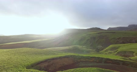 inspiradora : Aerial shot of sunset over grassy rolling hills. Vik countryside in Iceland.
