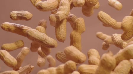 peanuts : Peanuts in the peel fly into the air in slow mo