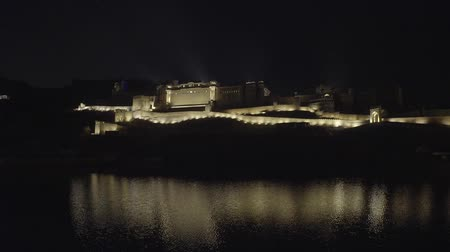 amer fort : Amer Fort (Amber Fort) illuminated at night at Light and Sound show, Jaipur, Rajastan, India reflecting in Maota lake.