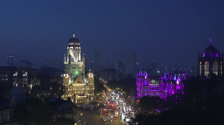 indie : Time lapse video of new illumination on Chhatrapati Shivaji Terminus (CST) formerly Victoria Terminus, is a UNESCO World Heritage Site and Brihan Mumbai Municipal Corporation (BMC) Building, Mumbai.