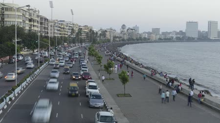 város : Time lapse of Vehicle Traffic in evening at Marine Drive the Queens necklace,with new electricity saving LED daylight like street lights, Mumbai, Maharashtra, India.