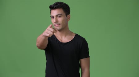 hispánský : Young handsome Hispanic man against green background Dostupné videozáznamy