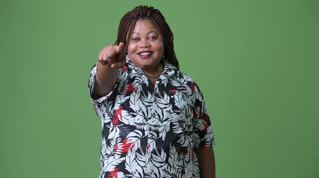 overweight : Overweight beautiful African woman against green background