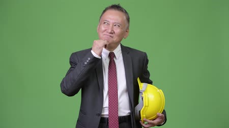 hand on chin : Mature Japanese businessman as engineer thinking