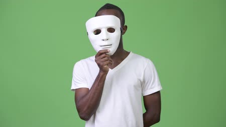 disguise : Young African man with white mask