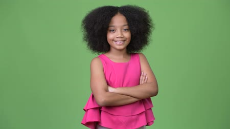 crossed arms : Young cute African girl with Afro hair crossing arms
