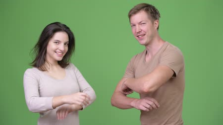 crossed arms : Young happy couple with arms crossed together Stock Footage
