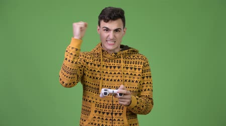 raising fist : Young handsome man playing games