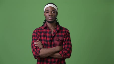saç bantı : Young handsome African man with dreadlocks against green background
