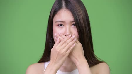 bilge : Young beautiful Asian businesswoman covering mouth as three wise monkeys concept
