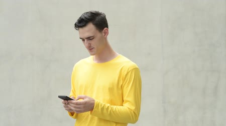 profil : Young happy handsome man using phone