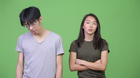 aborrecido : Young Asian couple looking bored together Stock Footage