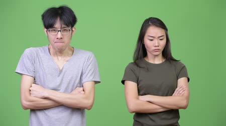 crossed : Young Asian couple getting angry together