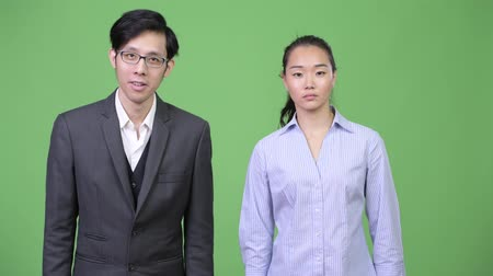 together trust : Young Asian business couple together Stock Footage