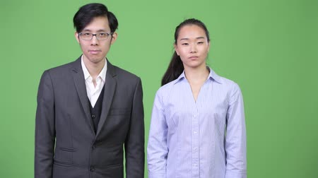 together trust : Young Asian business couple nodding head no together