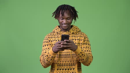 barba : Young happy African man using phone Stock Footage